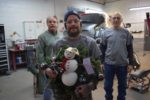 Nagy's Collision Hartville Painter Jason McDaniel (Front Center) Stands with his Snowman Wreath that won the Nagy's Annual Christmas Decorating Contest