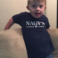 Nagy's Collision Centers donates to the Up Side of Downs Northeast Ohio