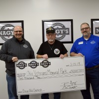 Ron and Dan Nagy present Ohio Veterans Memorial Park President, Chuck Nichols with their first place check for Nagys 2018 Deer Hit Contest.